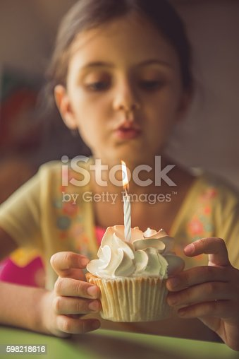 istock Charming little girl at home 598218616