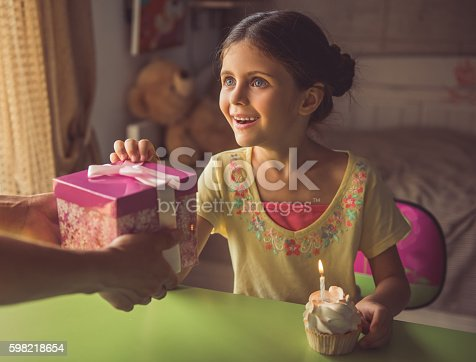 istock Charming little girl at home 598218654