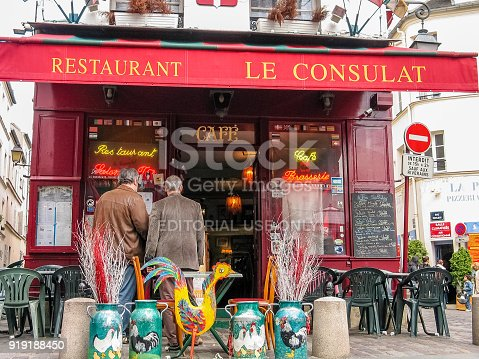 istock Charming little restaurant Le Consulat on Montmartre hill in Paris, France. 919188450