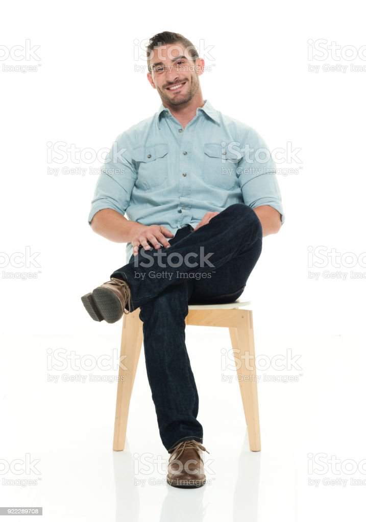 Charming man seated and smiling stock photo