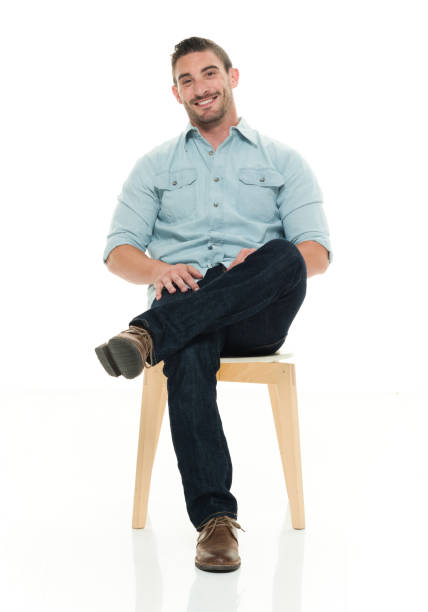 charming man seated and smiling - sitting stock pictures, royalty-free photos & images