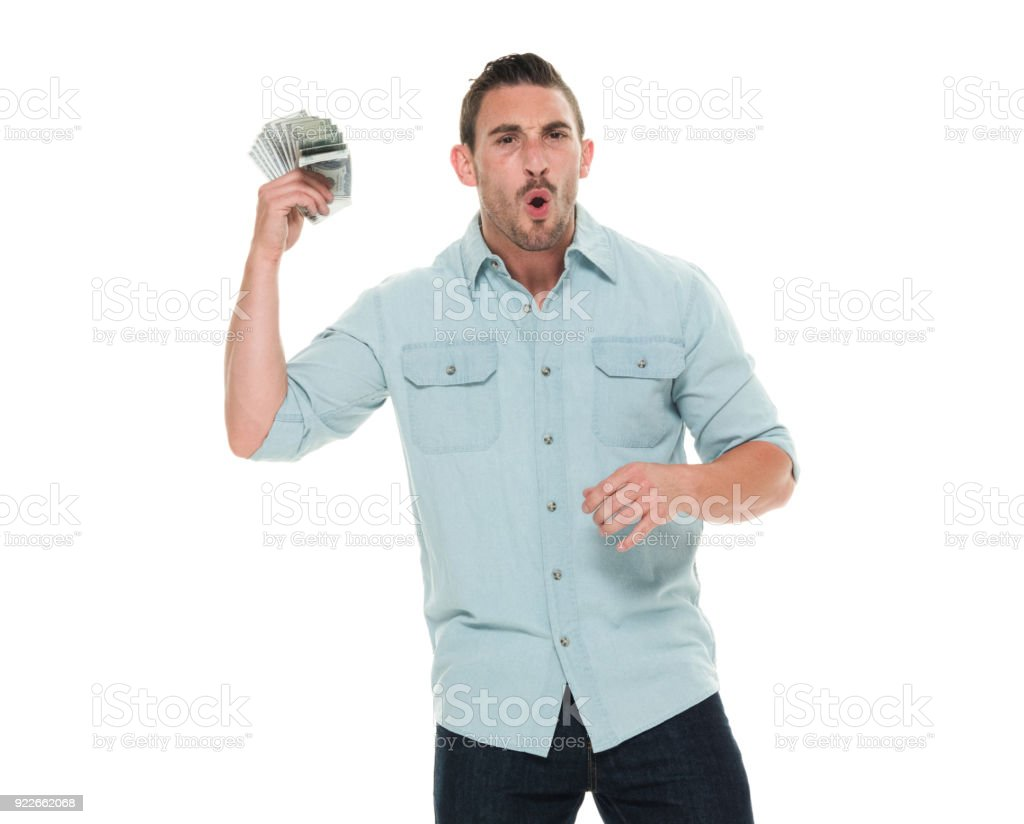 Charming man waist up holding up cash and being excited stock photo