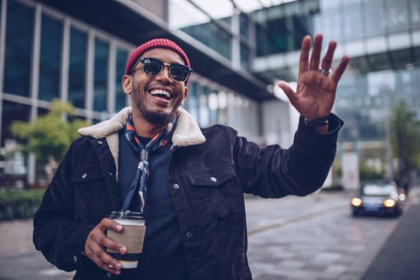 charming man waving - sventolare la mano foto e immagini stock