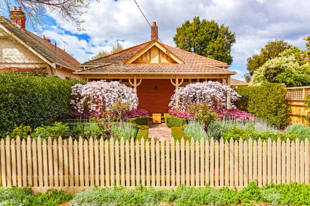 Charming Melbourne bungalow home with formal front garden, picket fence Charming 100 year-old Melbourne bungalow in leafy eastern suburbs with neat formal front garden picket fence saxifragales stock pictures, royalty-free photos & images