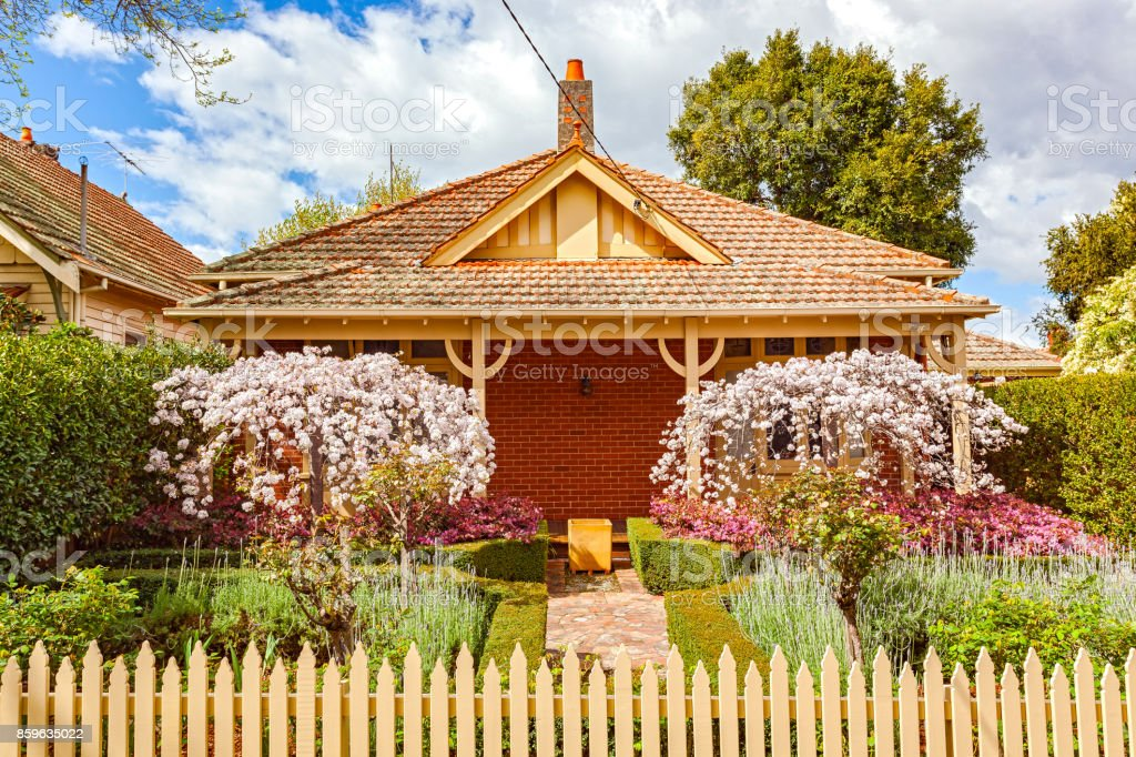 Charming Melbourne bungalow home with formal front garden, picket fence stock photo