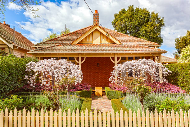charming melbourne bungalow home with formal front garden, picket fence - charming stock photos and pictures