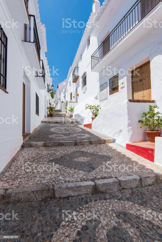Charming narrow historic streets of white village Frigiliana. royalty-free stock photo