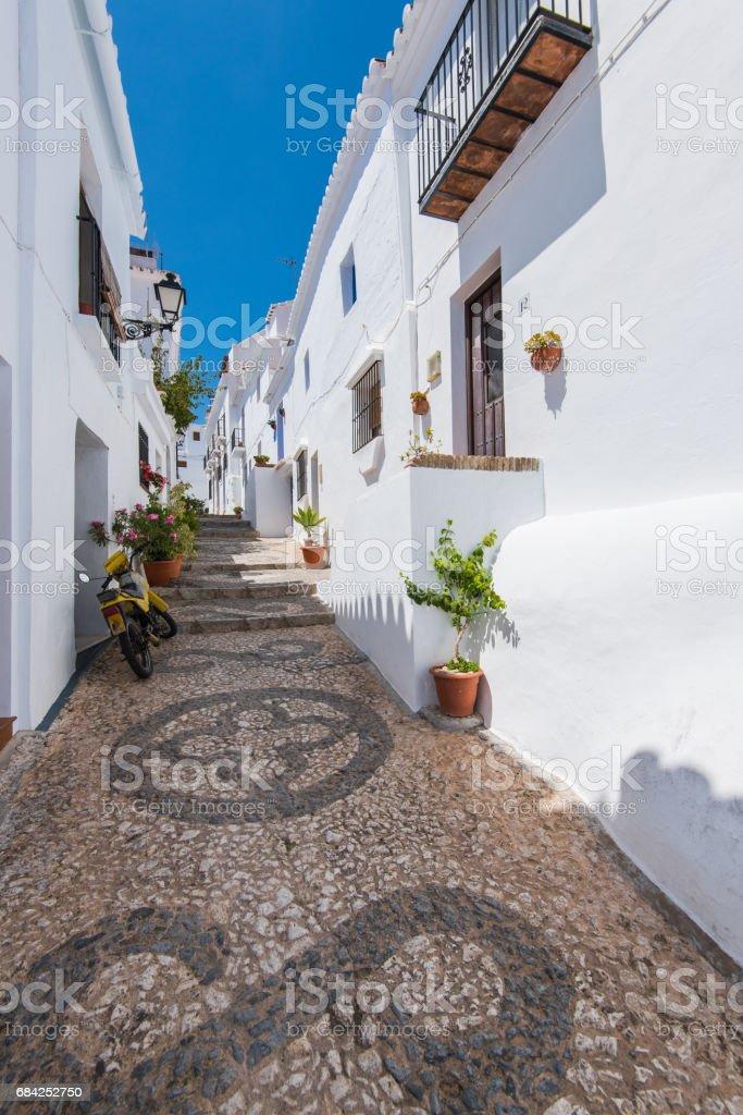 Charming narrow historic streets of white village Frigiliana. royalty-free stock photo