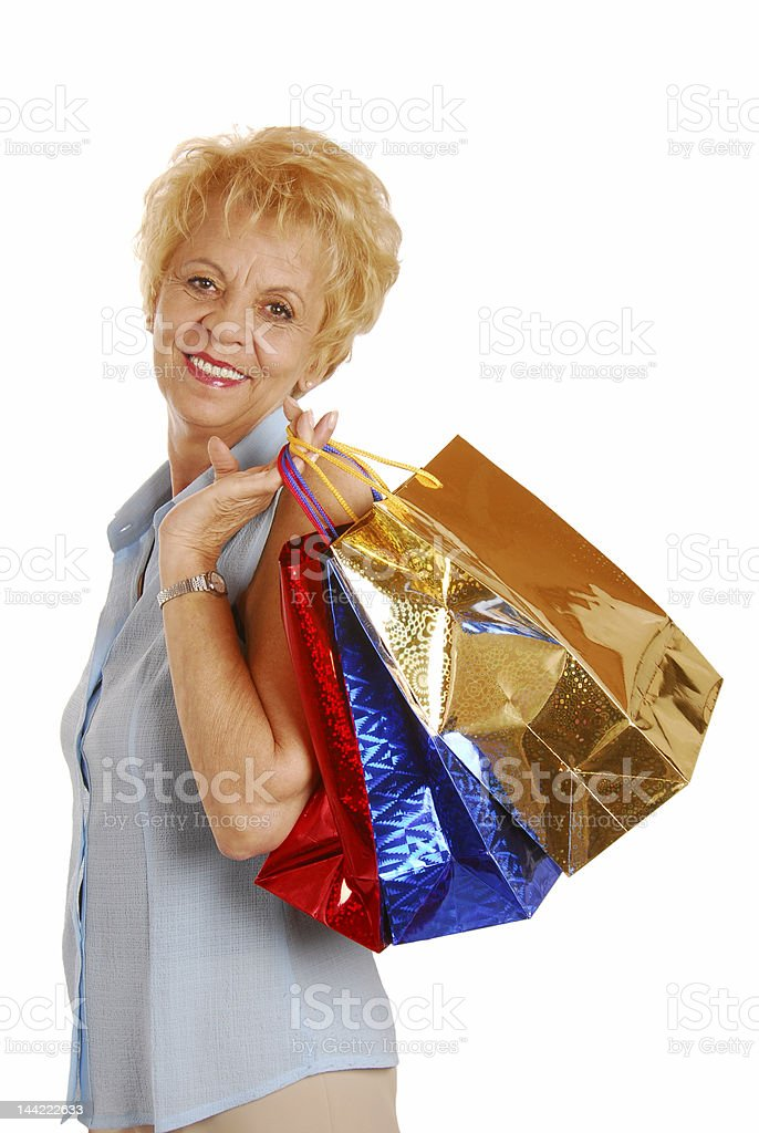 Charming old lady with gifts royalty-free stock photo