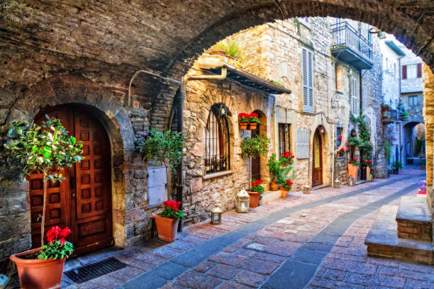 Charming old street of medieval towns of Italy, Umbria region beautiful flower decorated streets of old towns in Italy umbria stock pictures, royalty-free photos & images