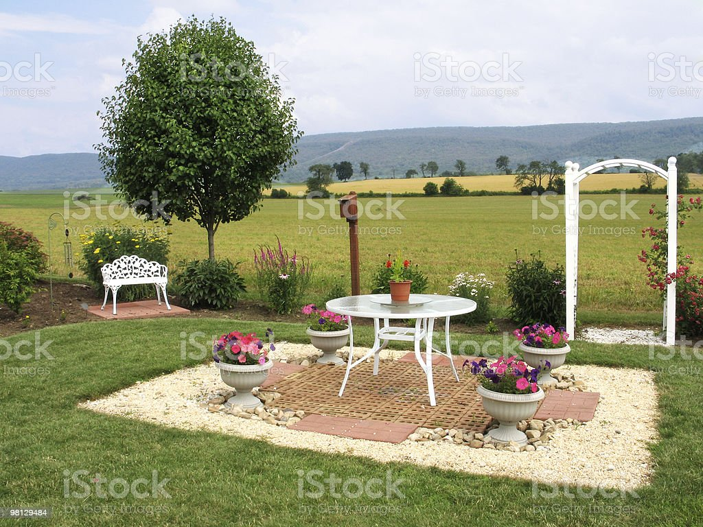 Charming patio adjoining fields royalty-free stock photo