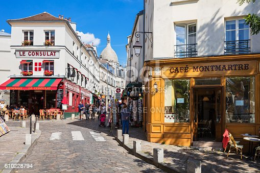 Paris, France - July 06, 2016: The charming quarter of Montmartre hill near basilica Sacre Coeur with traditional french cafes and art galleries. Montmartre is one of the most visited landmarks in Paris