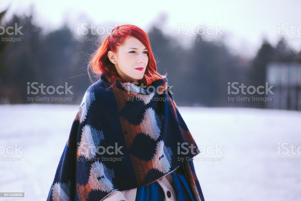 Charming Redheaded Woman At Cold Winter Day stock photo