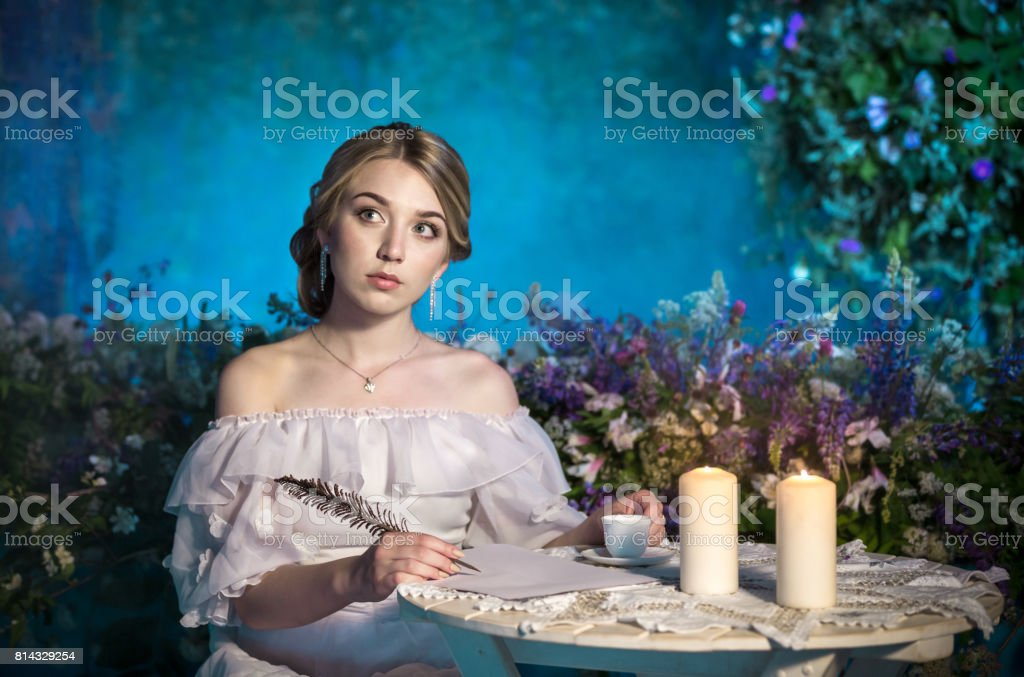 Charming Romantic Girl In Historical Dress Is Dreaming stock photo