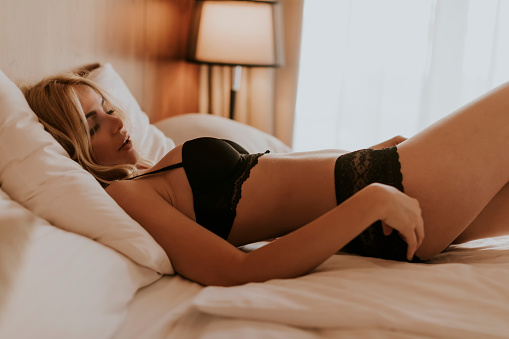 Charming Sexy Woman In Lingerie Lying On The Bed Stock Photo - Download  Image Now - iStock