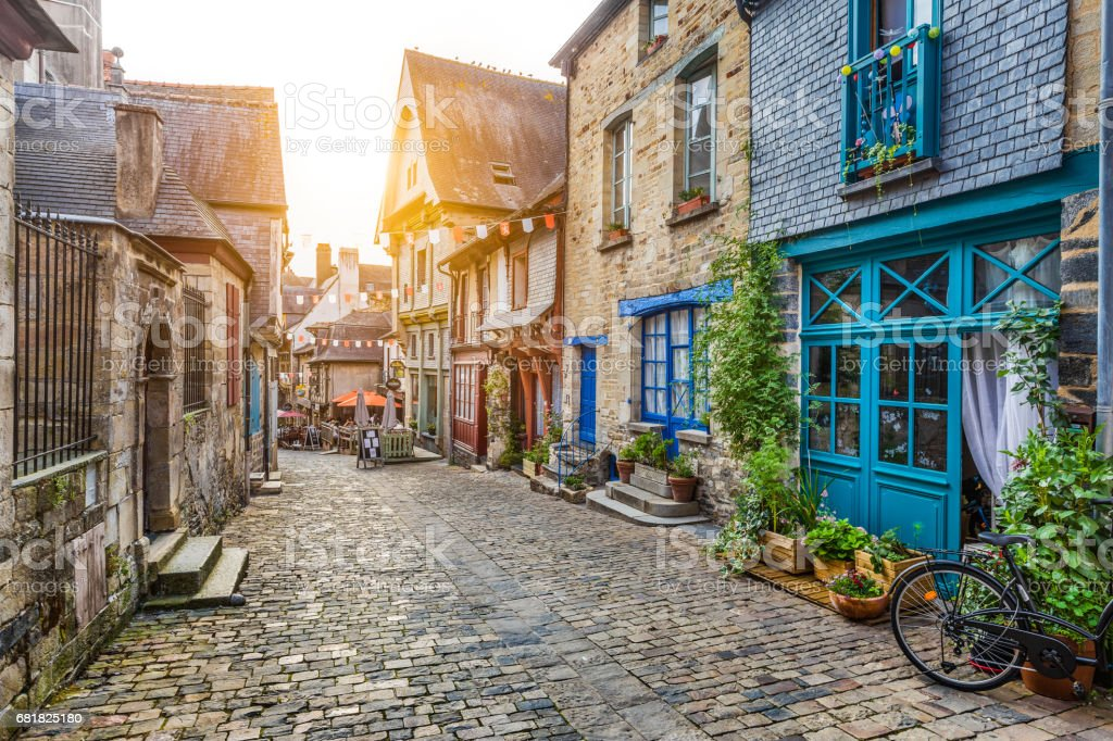 Charming street scene in an old town in Europe at sunset stock photo