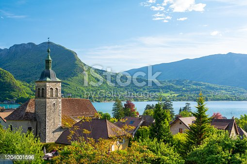 istock charming view on Annecy lake with old church in France 1204001596