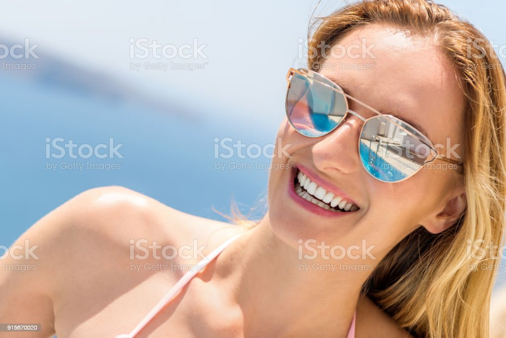 4880ea74f83 Charming woman in sunglasses   beach holiday royalty-free stock photo