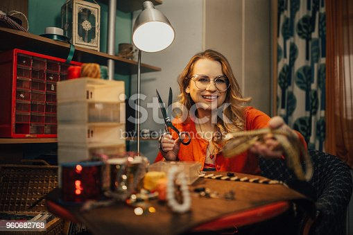 512345816istockphoto Charming woman making bijouterie in the workshop 960682768