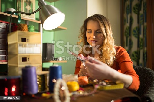 512345816istockphoto Charming woman making bijouterie in the workshop 960682780
