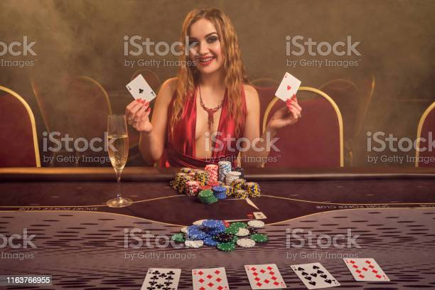 Charming Woman With A Beautiful Hairstyle And Perfect Makeup Is Playing Poker  Casino Stock Photo - Download Image Now - iStock