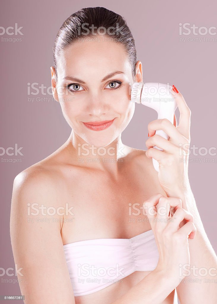Charming woman with brush for deep cleansing facial. stock photo