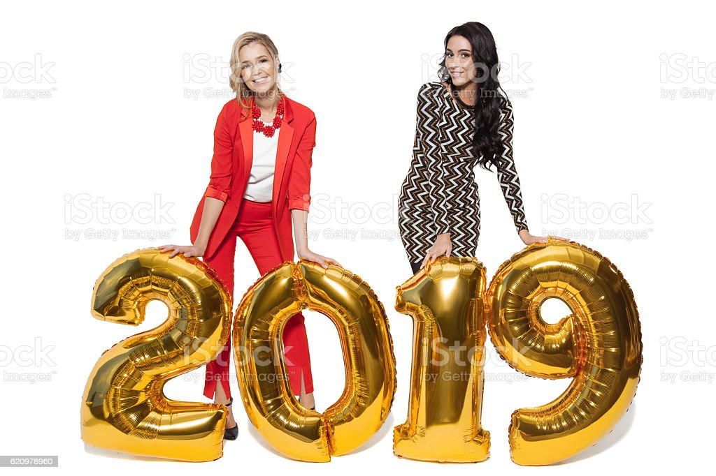 Charming Women Holding Big Golden Numbers 2019. Happy New Year. foto royalty-free