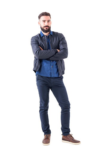 931173966 istock photo Charming young adult male in dark blue bomber jacket with crossed hands looking at camera. 931173358