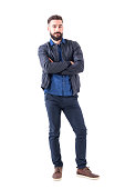 istock Charming young adult male in dark blue bomber jacket with crossed hands looking at camera. 931173358