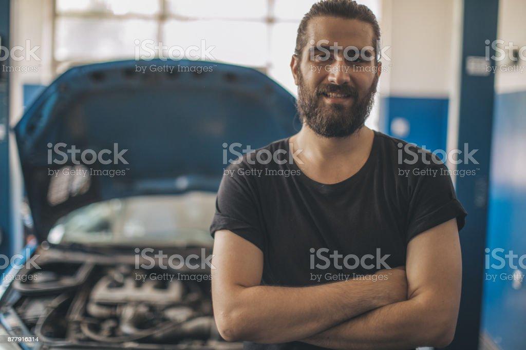 Charming young auto mechanic stock photo