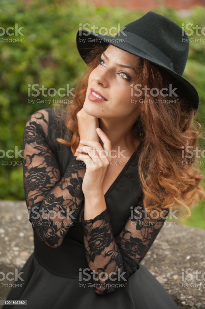 Charming Young Light Brown Hair Brunette Woman With Big Black Hat