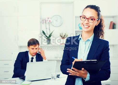 istock charming young woman manager holding cardboard in office 592007098