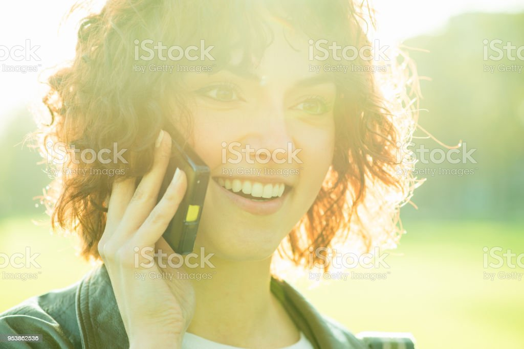 Charming Young Woman on the Phone stock photo