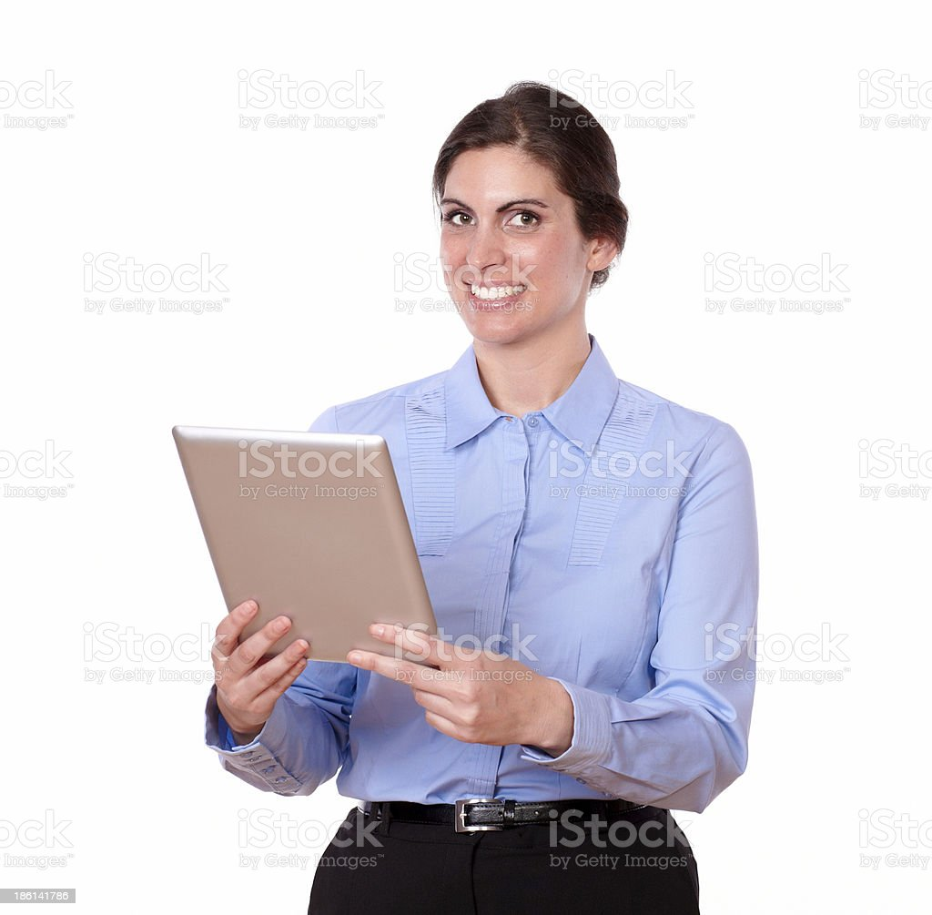 Charming young woman standing using tablet pc royalty-free stock photo