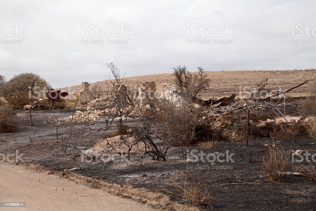 Charred remains of an old stone cottage stock photo