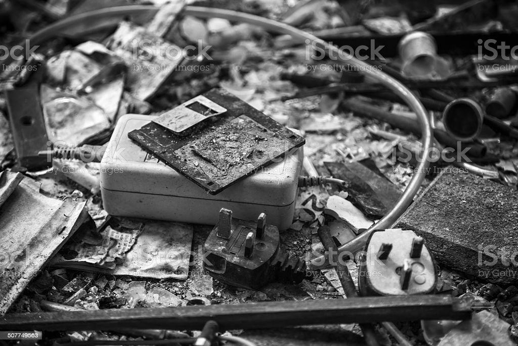 Charred remains of floppy disk and office equipment stock photo