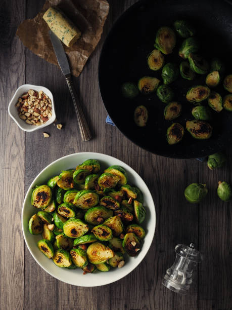 Charred sprouts with spicy herb butter and fine chopped hazelnuts stock photo