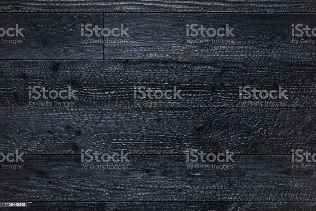 Charred wooden boards texture background. Black wooden background....