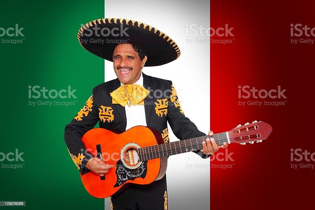 Charro Mariachi playing guitar in Mexico flag stock photo