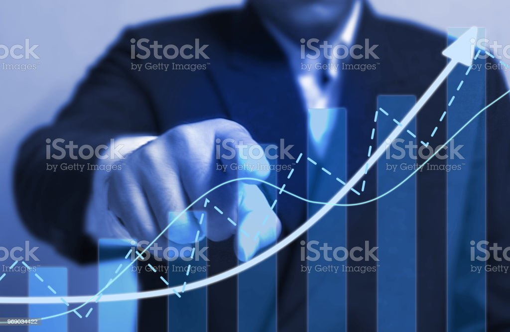 Chart direction up trend and volump with background  business man point finger. stock photo