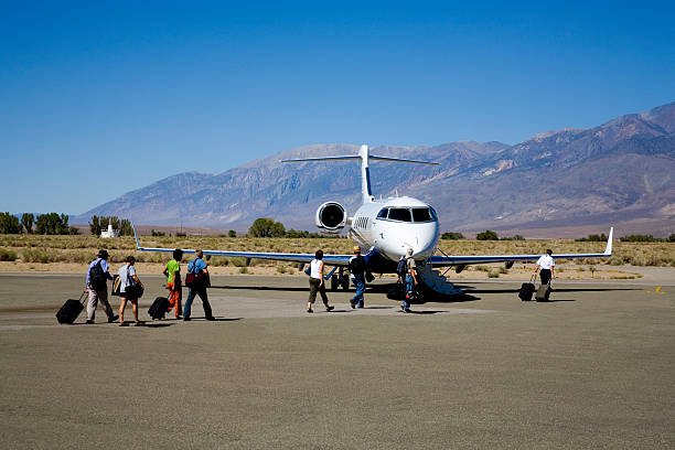 Charter Jet and Passengers stock photo