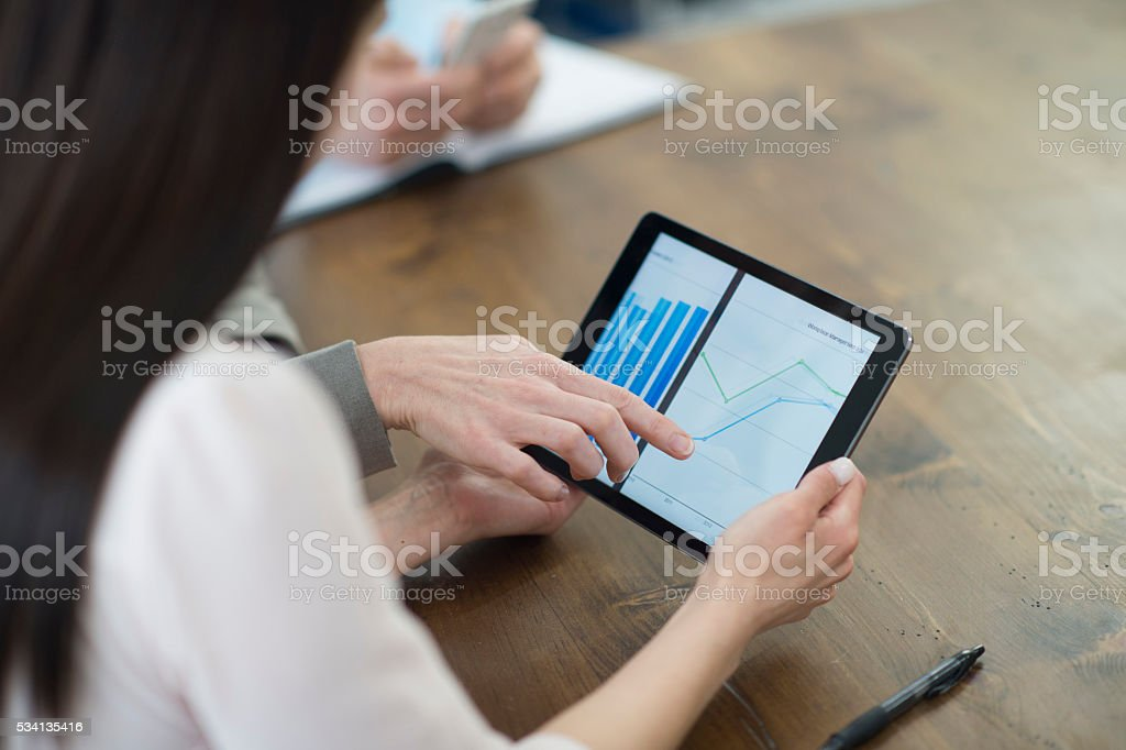 Charting Reports on a Digital Tablet stock photo
