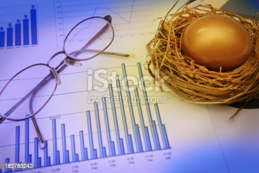 A bar chart/graph with a golden nest egg and spectacles.