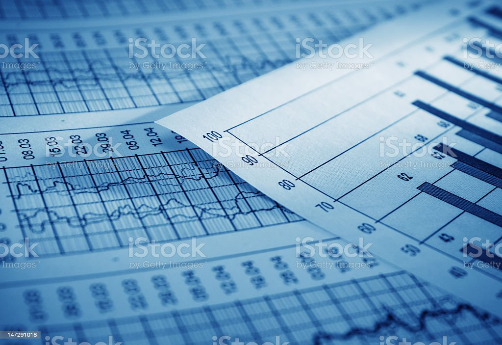 Charts and graphs close-up stacked papers royalty-free stock photo