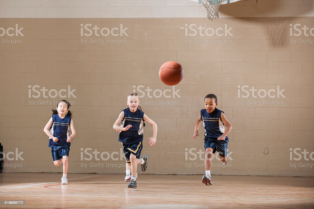Chasing a Ball Down the Court stock photo