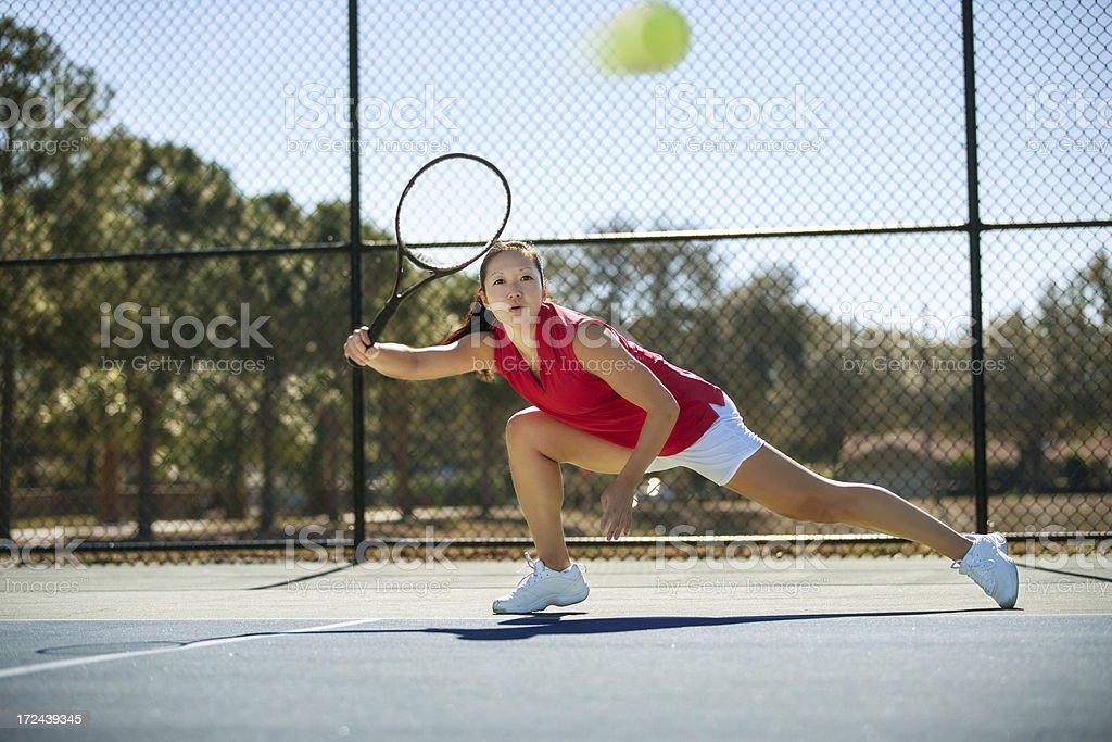 chasing down a tennis ball stock photo