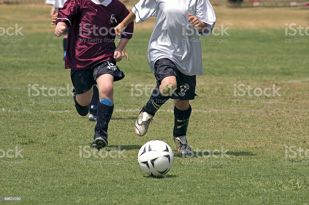 Chasing down the soccer ball stock photo