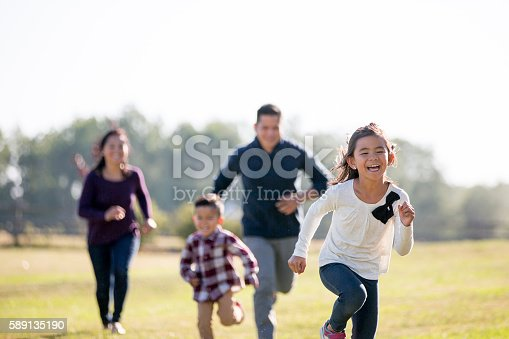 589135214 istock photo Chasing Each Other Outside 589135190