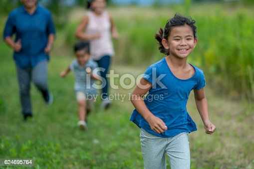 589135214 istock photo Chasing Each Other Through the Park 624695764