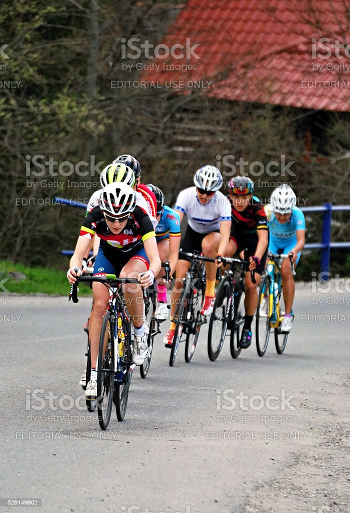 chasing group during women cycling race stock photo